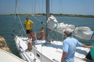 Charter both sailboats for group fun